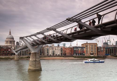 St Pauls and millenium bridge with boat